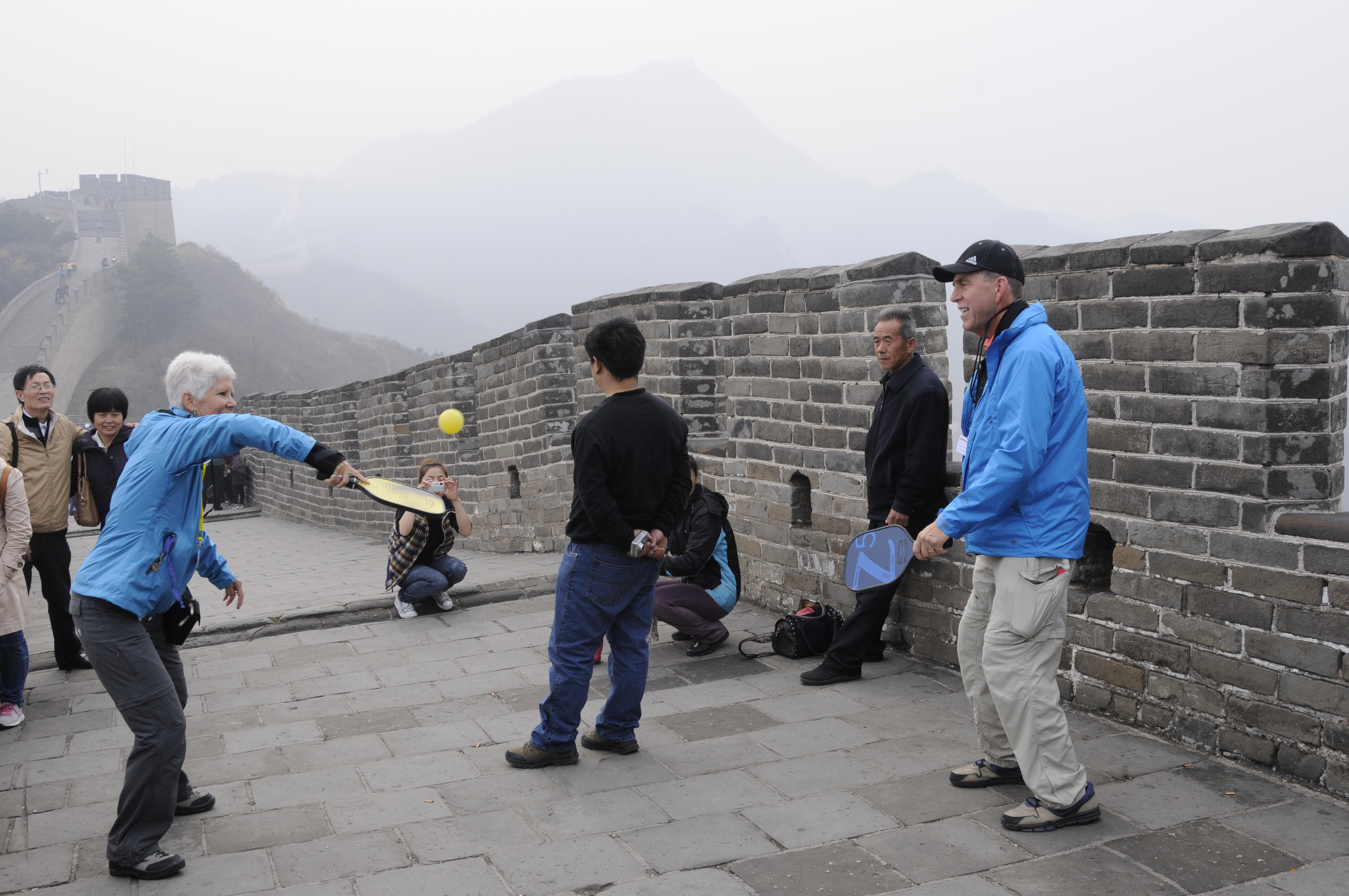 """Connie & Bob Anderson """"playing"""" pickleball on the Great Wall."""